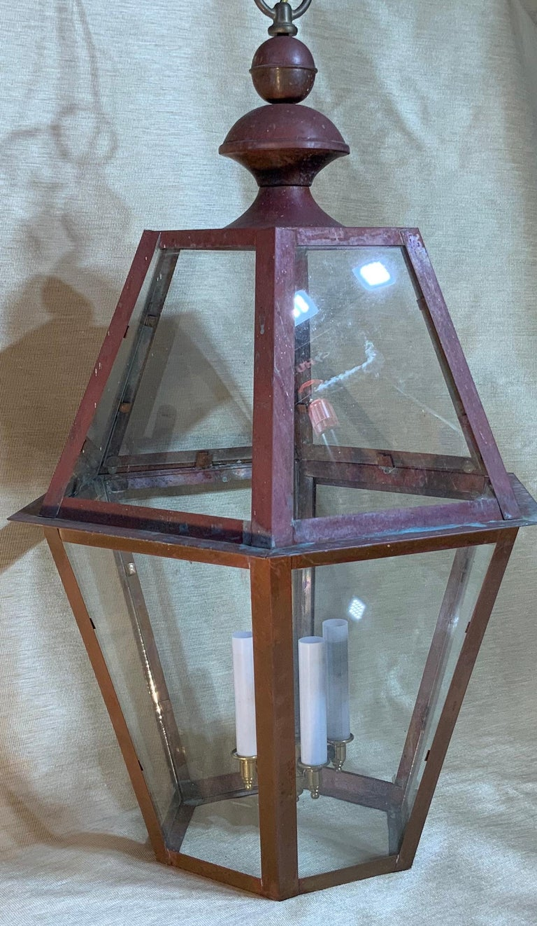 Exceptional six side hanging lantern made of handcrafted solid copper. Brass stem with four 60/watt lights, suitable for wet location Up to US code UL approved, great look indoor outdoor. Copper canopy and chain included.