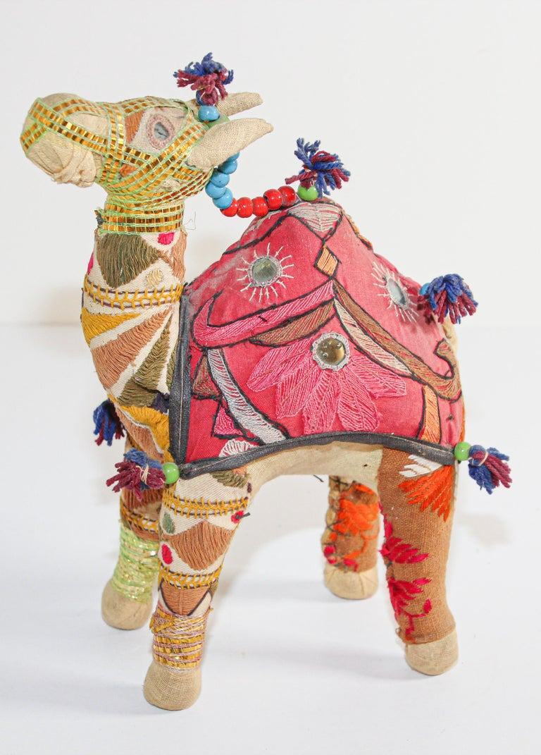 Handmade in Rajasthan, India, colorful fabric camel toy. Vintage small camel stuffed cotton embroidered and decorated with small mirrors, great collector piece. Anglo Raj, small stuffed camel wearing the ceremonial folk attire made from