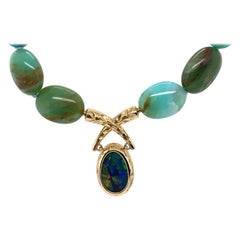 Hand-Engraved 18 Karat Yellow Gold Black Opal Clasp on Peruvian Opal Necklace