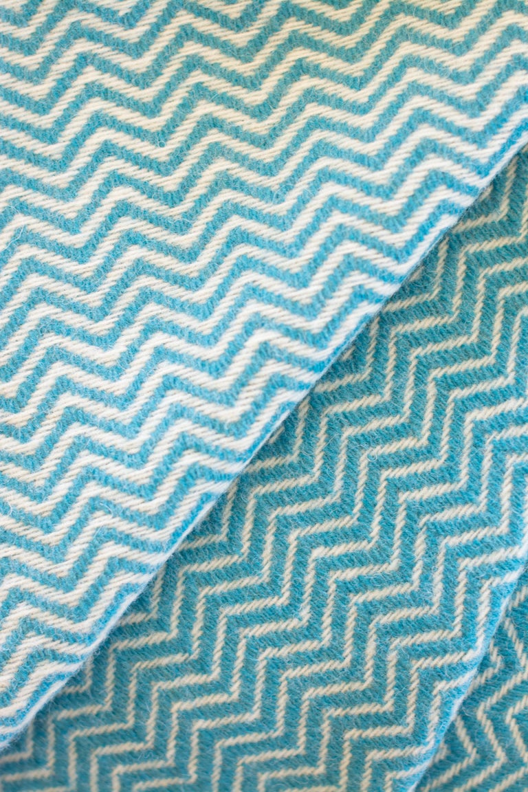 The Otilia Wave pattern blanket/throw has been created by an incredible and unique family owned weaving and textile company in Portugal. This company impressed us so much by their commitment to working with the environment, their dedication to their