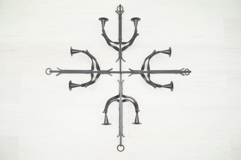 These hand forged wall candleholders were produced in France, circa 1950s.