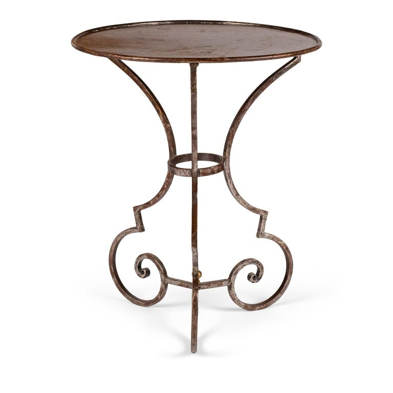 Hand forged steel garden table in distressed finish.
