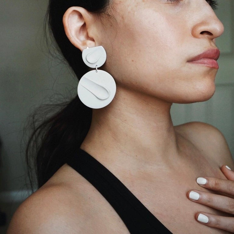 Hand formed earrings made of ultra lightweight polymer clay. Features a hypoallergenic titanium post embedded in polymer for longevity.