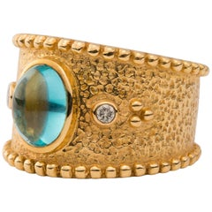 18 Karat Gold Ring with Oval Cabochon Blue Tourmaline and Diamonds