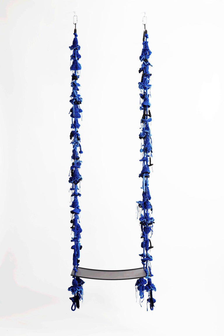 The royal blue iota swing, inspired by climbing plants, takes the user to a wild, natural, fantastic place. The swing showcases much of our special knitted hand work. The numerous intricate elements that form the swing are hand knit with bespoke