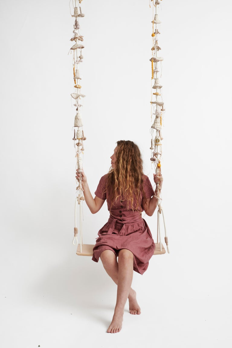 The peach blossom swing, inspired by climbing plants and delicate peach colors, takes the user to a wild, natural, fantastic place. The swing showcases much of our special knitted hand work. It contains 93 hand knitted elements changing in shape,