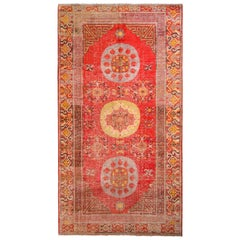 Hand-Knotted Antique Khotan Rug in Red and Gold with Medallion Patterns