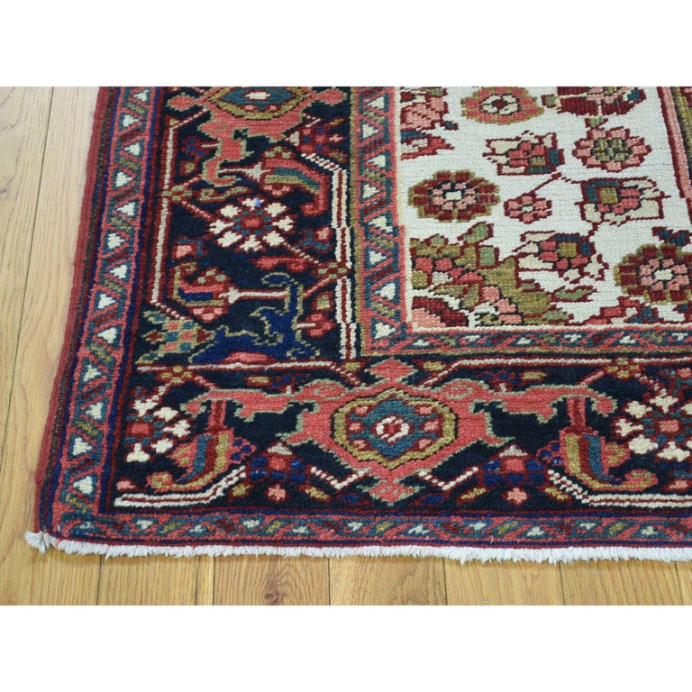 This is a truly genuine one-of-a-kind hand knotted antique Persian Heriz mint condition Oriental rug. It has been Knotted for months and months in the centuries-old Persian weaving craftsmanship techniques by expert artisans. Measures: 4'6