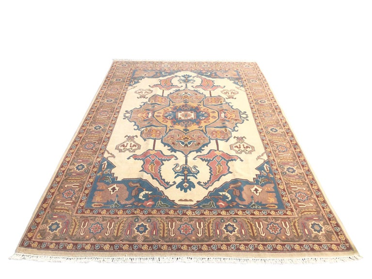 Hand knotted Chinese rug with wool pile and cotton foundation. The design of this piece has been inspired by well-known Persian Heriz rug design which is famous among designer because of the soft colors, center medallion and geometric pattern. This