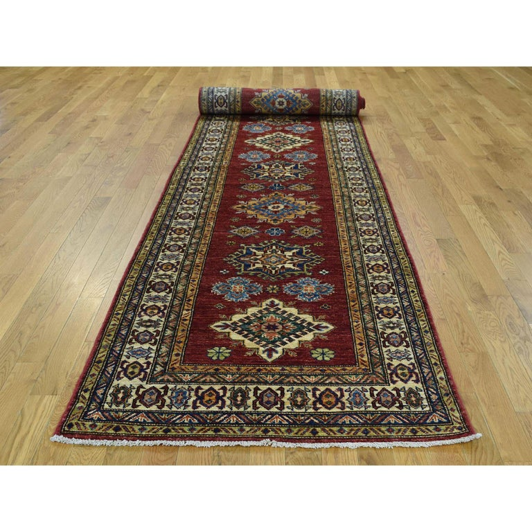 This is a truly genuine one-of-a-kind hand knotted pure wool super Kazak Oriental wide runner rug. It has been knotted for months and months in the centuries-old Persian weaving craftsmanship techniques by expert artisans. Measures: 3'4