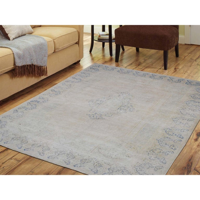 This is a truly genuine one-of-a-kind hand knotted pure wool vintage Kerman white wash Oriental rug. It has been knotted for months and months in the centuries-old Persian weaving craftsmanship techniques by expert artisans. Measures: 7'0
