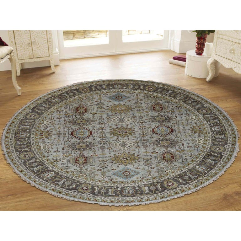 This is a truly genuine one-of-a-kind hand knotted silver Karajeh design pure wool round oriental rug. It has been knotted for months and months in the centuries-old Persian weaving craftsmanship techniques by expert artisans. Measures: 8'0