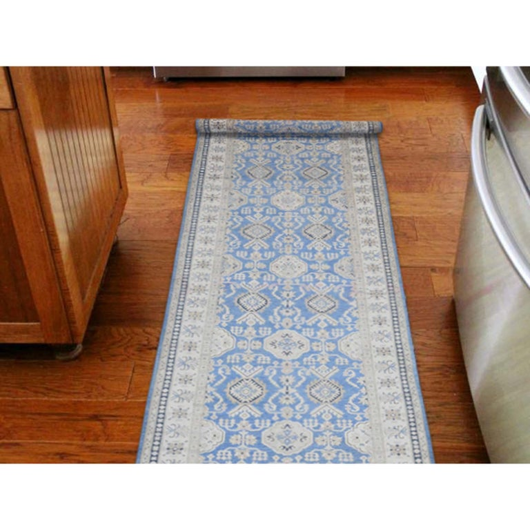 This is a truly genuine one-of-a-kind hand knotted wide runner vintage look Kazak pure wool Oriental rug. It has been knotted for months and months in the centuries-old Persian weaving craftsmanship techniques by expert artisans. Measures: 5'0