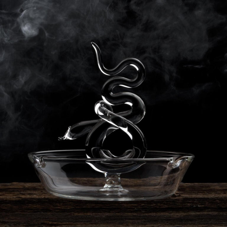 Handmade glass ashtray from Serpentine Collection. Collection of serpentine table objects composed of liquor bottles, martini glasses, and ashtrays. Inspired by the snake iconography of the18th century prints, the vices are represented with their