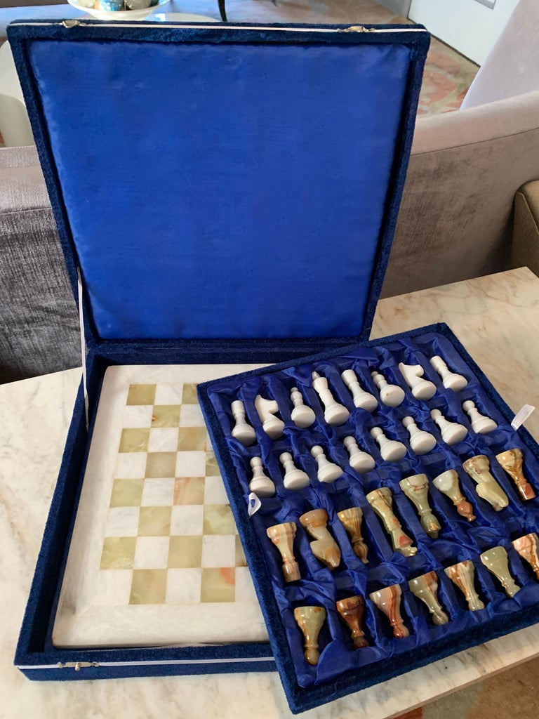 A completely handmade set of marble and onyx chess pieces and marble board, in handmade box. The decorative box that is included has been handmade of velvet and paper, a wonderful gift, family heirloom or the perfect travel chess set.  Measures: