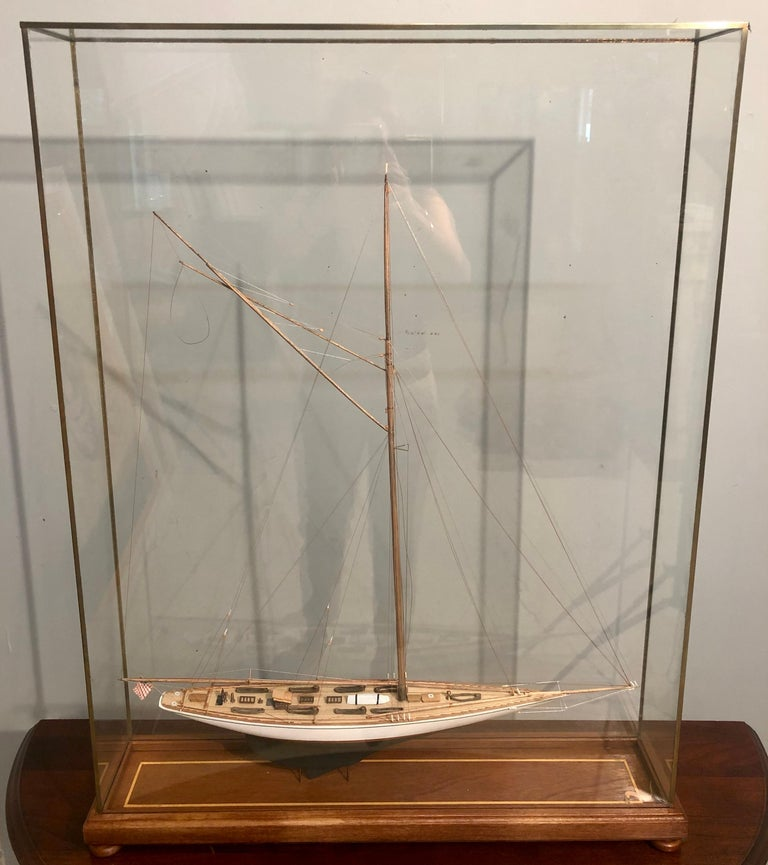 Hand modeled clipper ship in a glass and bronze case waving the American flag. A simply stunning clipper ship model leaving no detail to attention undone. A seemingly spectacular crafted ship as life like as possible in a custom all glass bronze