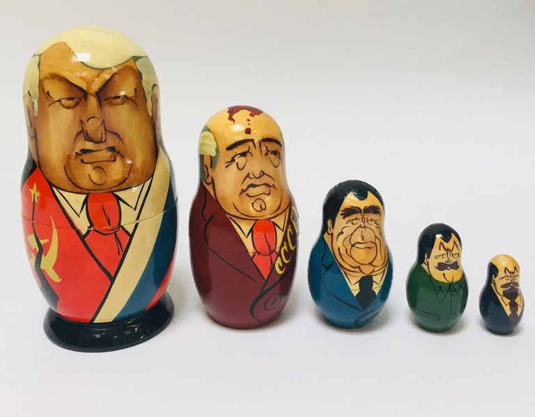 Matryoshka of soviet politicians, soviet era, USSR, circa 1990s. Vintage hand painted Matryoshka from the end of soviet Eera in USSR. This Matryoshka doll is made of beech wood with hand painted politician figures of the Soviet era. The biggest is