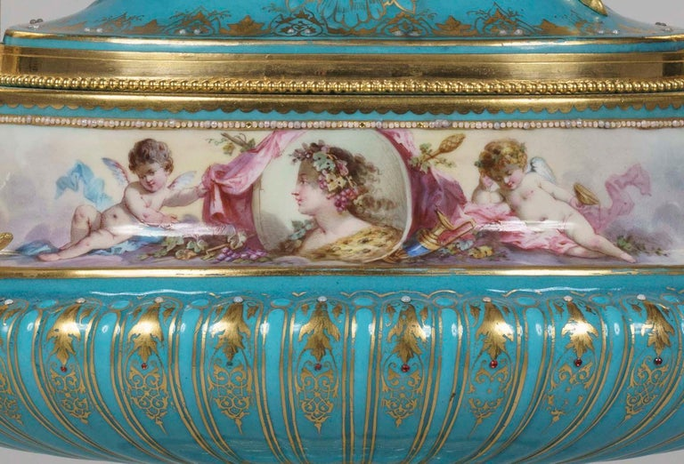 A hand painted and ormolu-mounted 'Sèvres' Porcelain urn in the Louis XVI Manner  The characteristic bleu celeste Sèvres-style porcelain body of oblate and bulbous form with gadrooned base bearing glass bead embellishments and mounted with