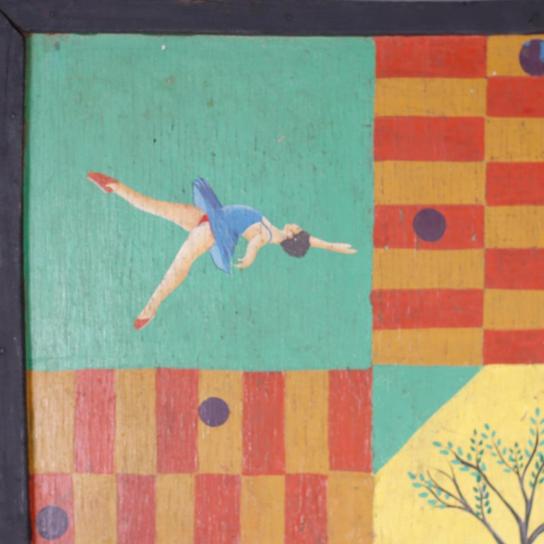 Vintage Haitian game board crafted in wood and hand painted with parrots, ballet dancers, and the tree of life in a rustic naive style and signed by the artist J Michel.