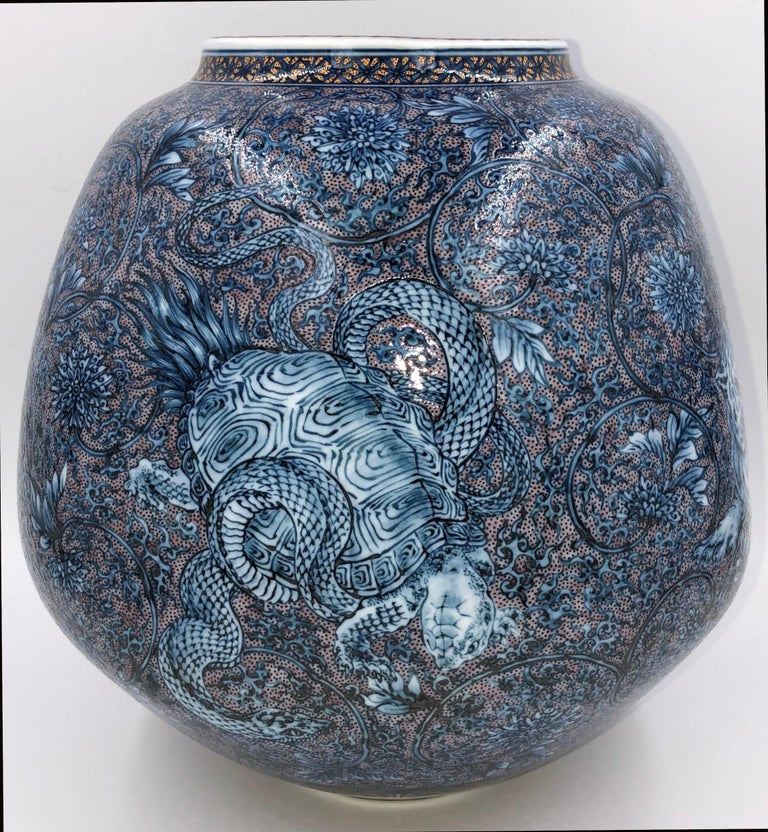 This highly detailed, intricately hand painted Japanese porcelain vase showcases the four auspicious creatures of Chinese mythology said to be the guardians of the four points of the compass. The vase is the joint creation of two brothers working in