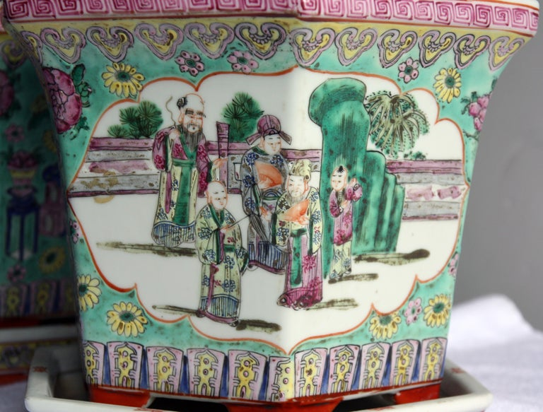 Lovely pair of hand-painted Chinese porcelain cachepot or jardinières with saucers.