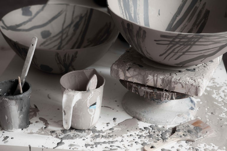 Acclaimed conceptual artist Bruce McLean debuts a vast new body of work titled Garden Ware that was exhibited at the Victoria and Albert Museum in London. The collection includes one-off earthenware creations by McLean, including vases, bowls,