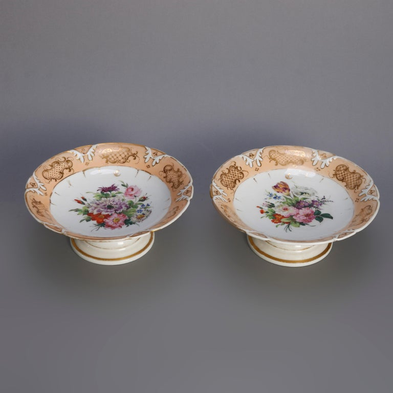An antique porcelain dessert set offers central floral reserve with rim having gilt highlights and includes two pedestal compotes and ten plates, 19th century  ***DELIVERY NOTICE – Due to COVID-19 we are employing NO-CONTACT PRACTICES in the