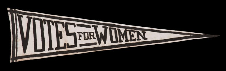 Hand painted suffragette pennant with strong graphics on an unusual white ground, 1910-1920  Triangular suffragette pennant, hand-lettered and decorated in black paint, on a length of plain weave, white cotton. The tapered profile is especially