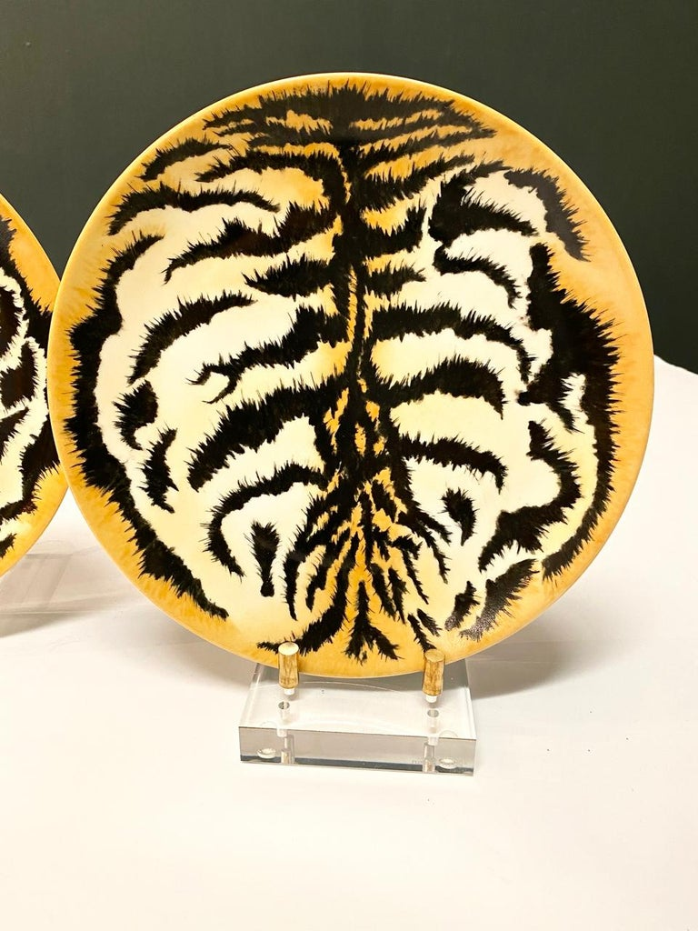 This is a highly decorative set of signed 9 dinner plates hand painted by the well-respected Odette de Bumiere, Palm Beach, 1988. These hand painted tiger plates would make a statement when hung together as a grouping.