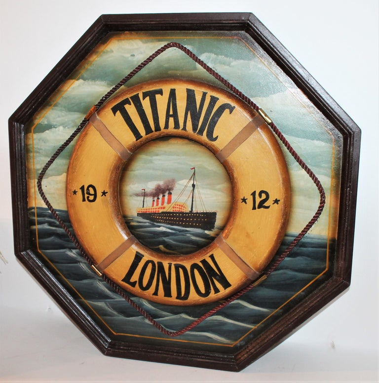 This handmade and painted Titanic trade sign is in good condition with wear on trim and small scratches throughout. This is a remake of the 19th century style trade signs. It reads