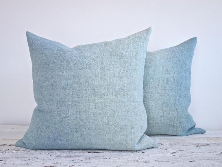 These one-of-a-kind linen pillows are handmade in Palma de Mallorca, Spain. Each of these pillows' hand-mixed colors is inspired by the light and color of this island, and the artisans hand paint each piece for layered texture and depth.  Size: