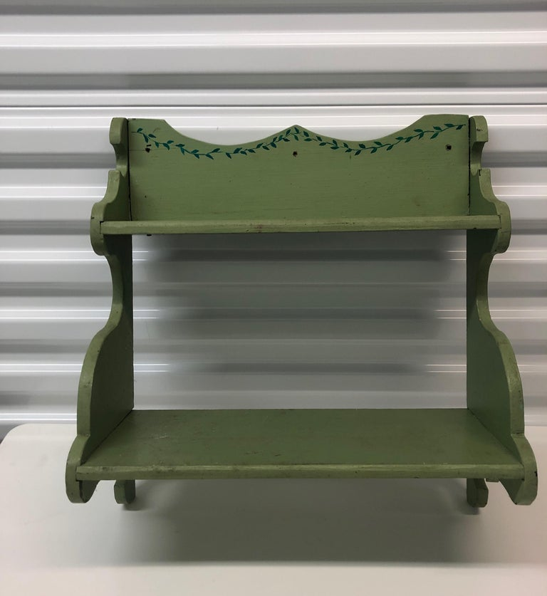 Hand painted wooden country wall display shelf.