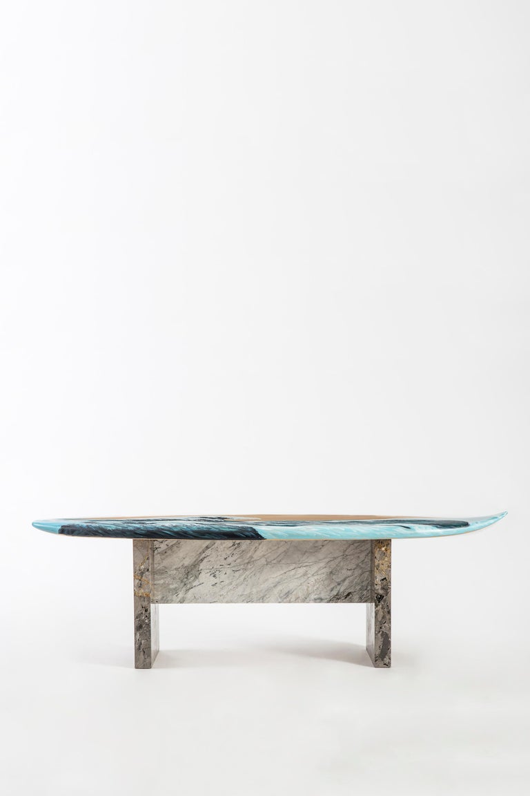 Motus.  A bench designed with the idea of constant movement, even when anchored to a fixed place, Motus combines handcrafted lime wood with contrasting marble legs. The seat is hand painted, with an image reminiscent of The Great Wave off