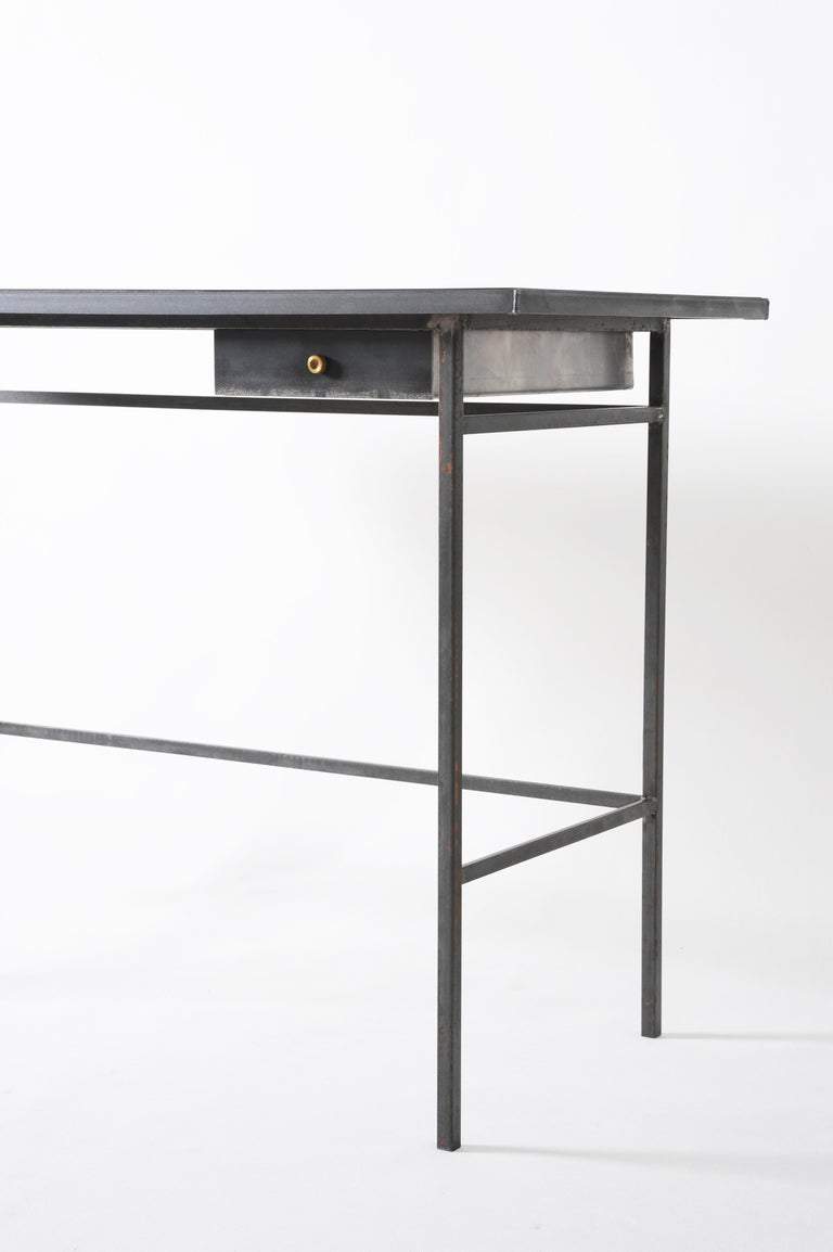 """Hand, sculpted desk, signed by Lukas Friedrich Desk """"Gloomy Sunday"""" Measures: 110 x 50 H 76 cm Finish: raw, waxed steel with brass drawer knob Top: dyed and oiled oak veneer (other options on demand) Limited Edition of 50 Signed"""