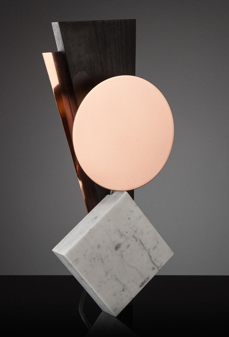 Hand-sculpted marble table lamp– Poise. Materials: Copper sprayed polished stainless steel, marble, ash. Dimensions: 36 x 17 x 4 cm Light: G9 LED bulb.   Skeld design is a contemporary design studio. We focus on interior lighting and