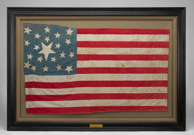 Presented is an impressive 21-star flag, circa 1860-1865. This is a southern-exclusionary 21-star flag constructed during the period of the American Civil War. The number of stars on this flag represent the number of states that remained loyal to