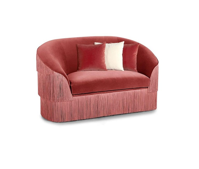 The handmade sofa draws on the signature Franjas fashion theme, ruffling the scene and inviting guests with its fun and flirtatious feel. Featuring three layers of fringes that run along the front and reverse of the wide seat, set against a curved