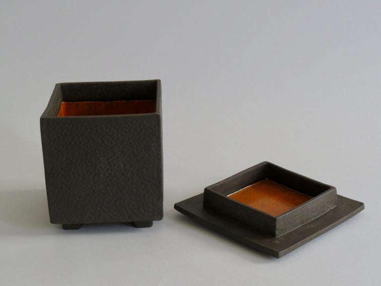 Hand built ceramic box. Subtly hand-textured clay box with a matching lid. The bare clay exterior highlights the handmade texture while an interior glaze surprises and shines. Very Japanese in design and attitude: quiet yet strong. Beautiful