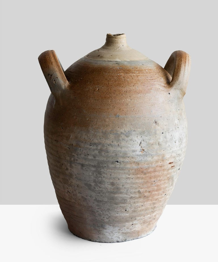 Hand thrown oil pot France, 19th century.  Hand thrown vessel with beautiful patina.