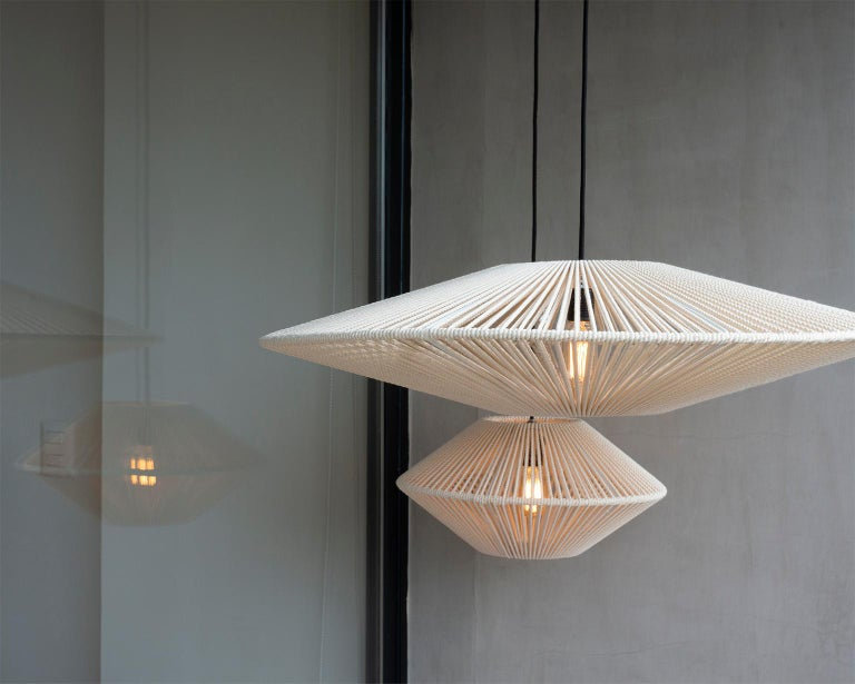 This Handwoven Bebop Tall Cotton Light Screen is a unique creation by León León Design from Mexico City.   The screen features a solid powder-coated steel structure and a handwoven Cotton rope weaving.  Handcrafted in small batches, every Lamp comes