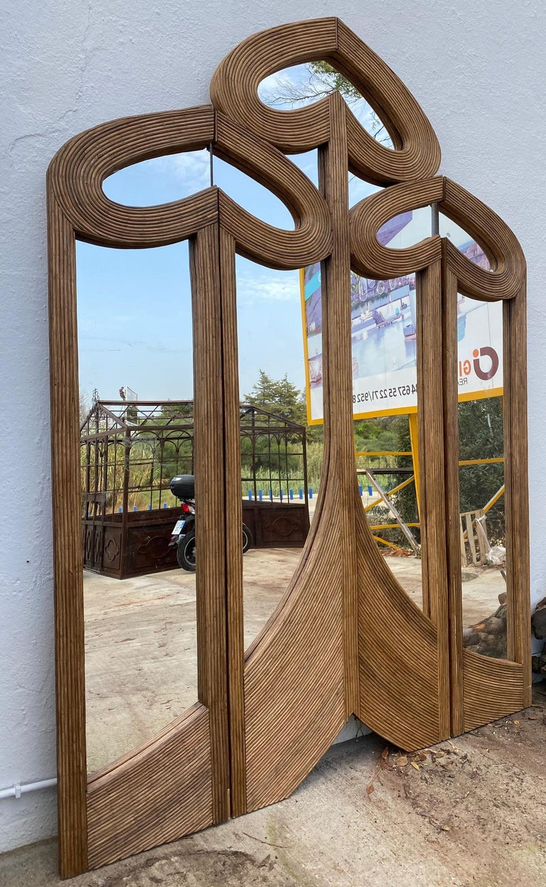 Handwoven wicker folding screen with mirrors.