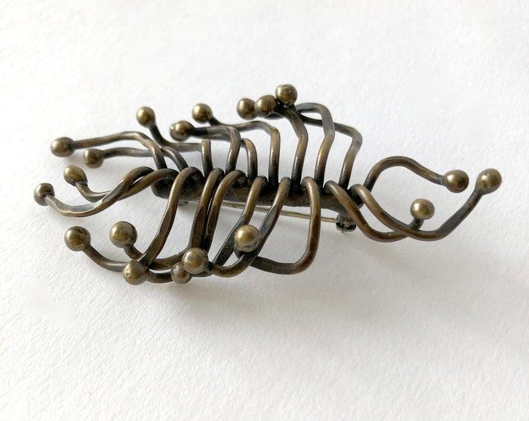 Sculptural, hand wrought brooch in organic form.  Brooch measures 1 1/2