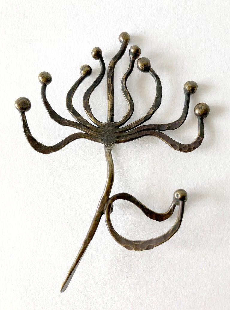 Hand wrought brooch in flower form.  Brooch measures 3.25