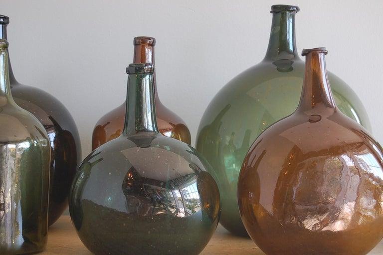 Country Handblown 19th Century Green Glass Bottle with Cork, Origin Sweden, circa 1890 For Sale