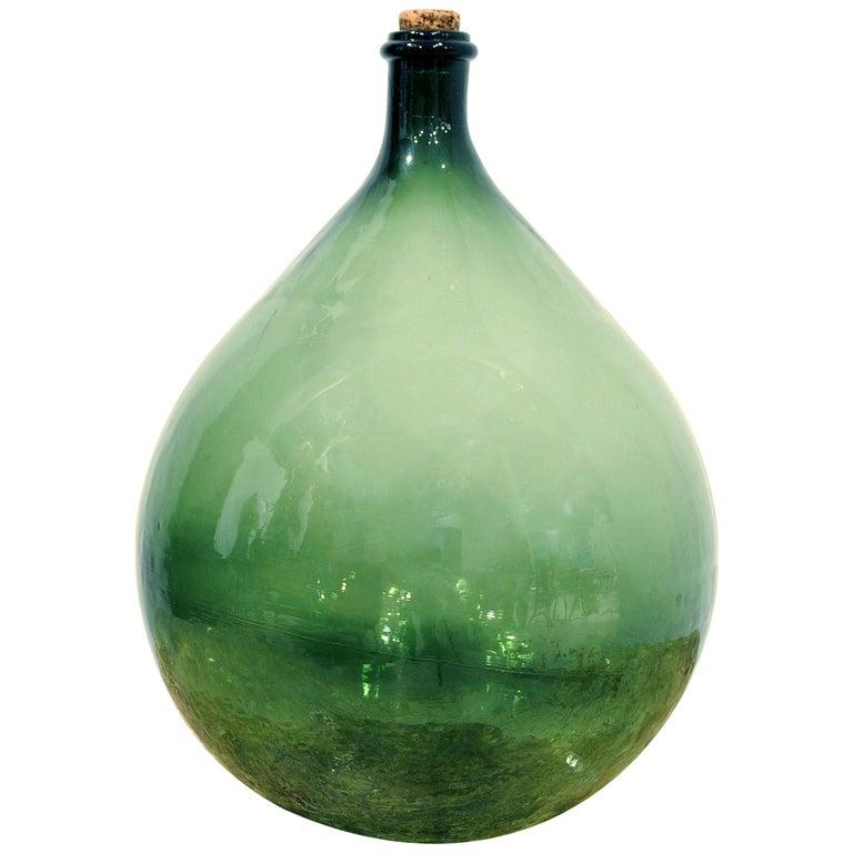 Handblown 19th Century Green Glass Bottle with Cork, Origin Sweden, circa 1890 For Sale