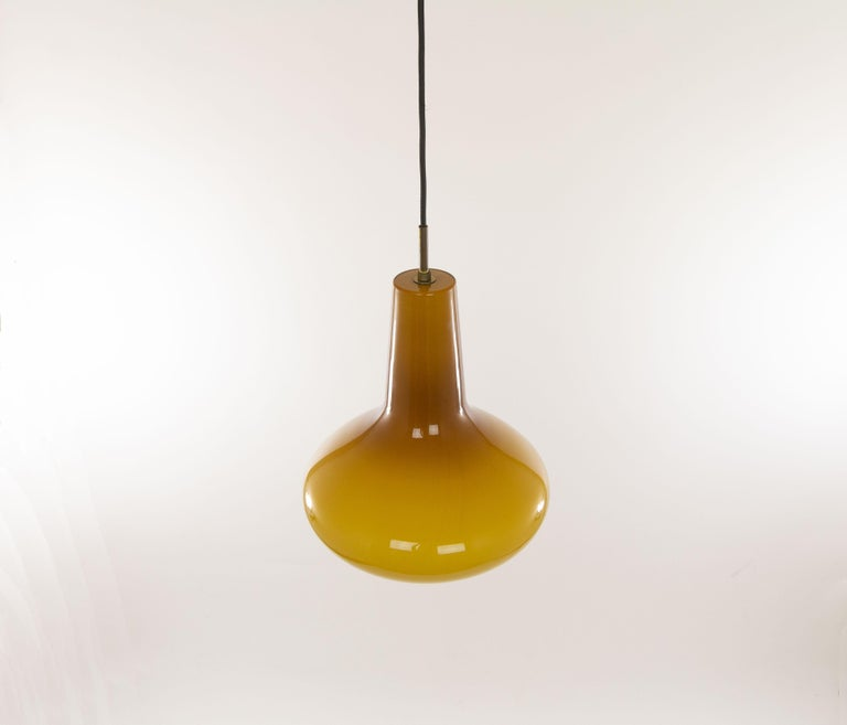Stunning hand blown glass pendant No. 011.13 designed by Massimo Vignelli at the start of his impressive career in design and executed by Murano glass specialist Venini. One of the most special lamps that Vignelli designed for Venini.  Original
