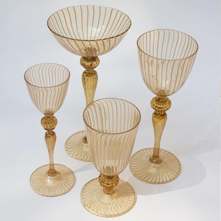 Handblown Lattice Murano stemware service for eight persons without a single chip. Featuring beautiful champagne goblets, red- and white wine goblets, aperitif glasses, plates and bowls creating a lovely table setting. The glass is lightly yellow
