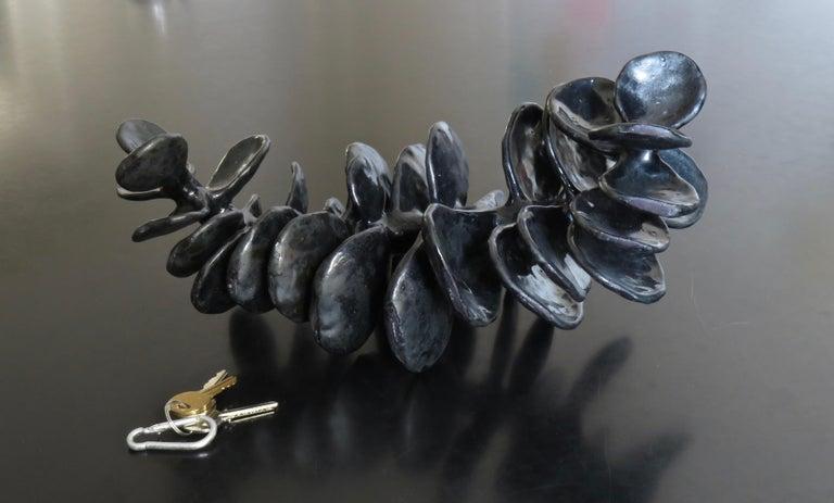 Handbuilt Ceramic Sculpture in Shiny Black Glaze, Skeletal and Undulating For Sale 4