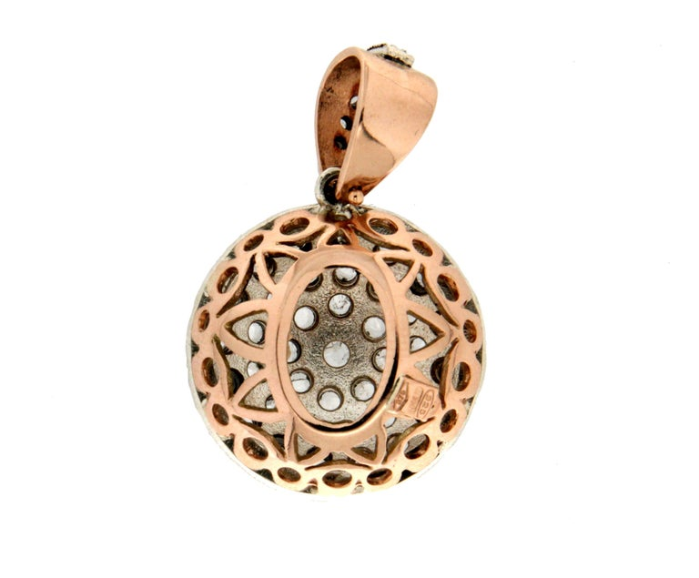 14 karat yellow gold and 800 karat silver pendant necklace. Handmade by artisans assembled with rose cut diamonds.  Pendant weight 8.40 grams (the price is without chain)