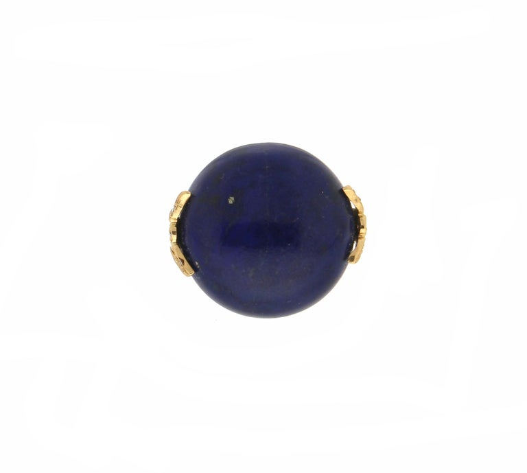 18 karat yellow gold cocktail ring. Handmade by our artisans assembled with lapis lazuli and diamonds.  Ring total weight 15.40 grams Diamonds weight 0.05 karat Lapis lazuli weight 8.50 grams Ring size 16.50 Ita 7.75 Us (all rings are can be resized)
